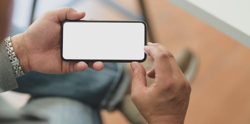 Photo of a Man Holding Smartphone