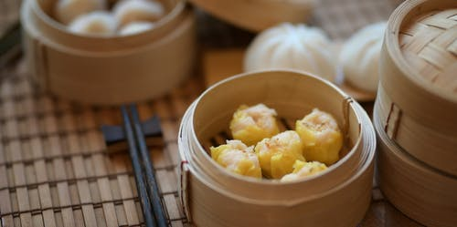 Close-Up Photo Of Dumplings On Bamboo Steamer