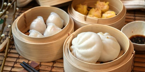 Close-Up Photo Of Steamed Buns On Bamboo Steamer