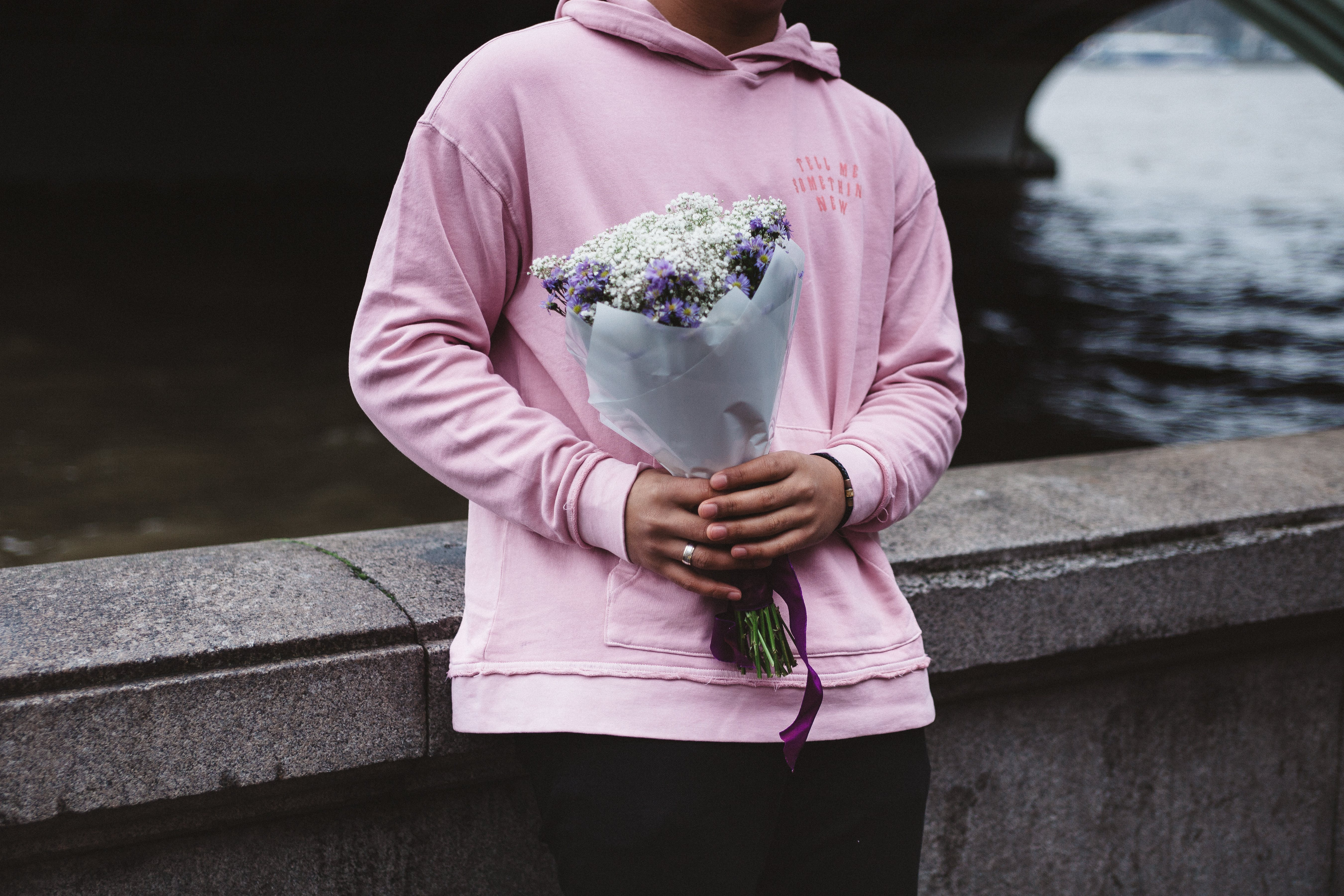 Person Holding Flower Bouquet