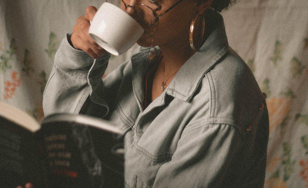 Woman Drinking Coffee in White Ceramic Mug