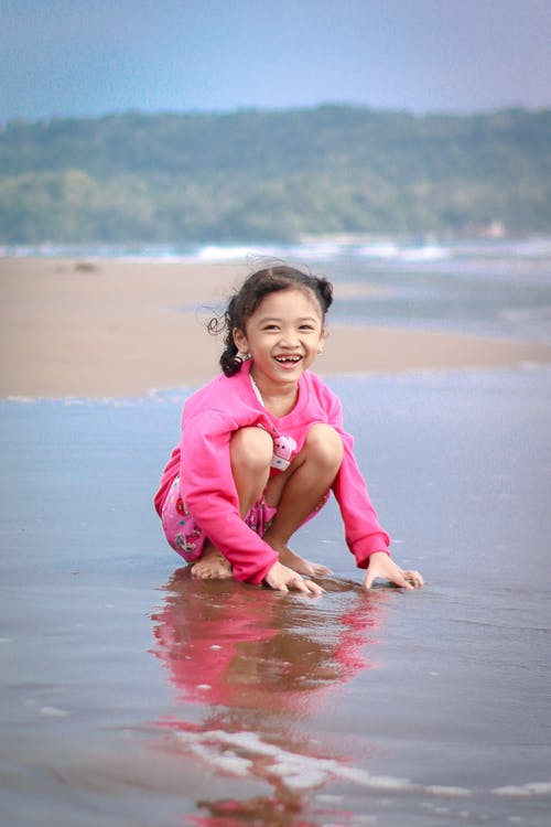 Photo Of Girl Beside Beach