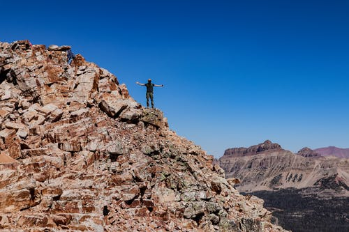 Man Standing on Mountain Range