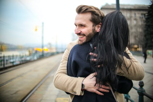 Photo Of Man Hugging Woman