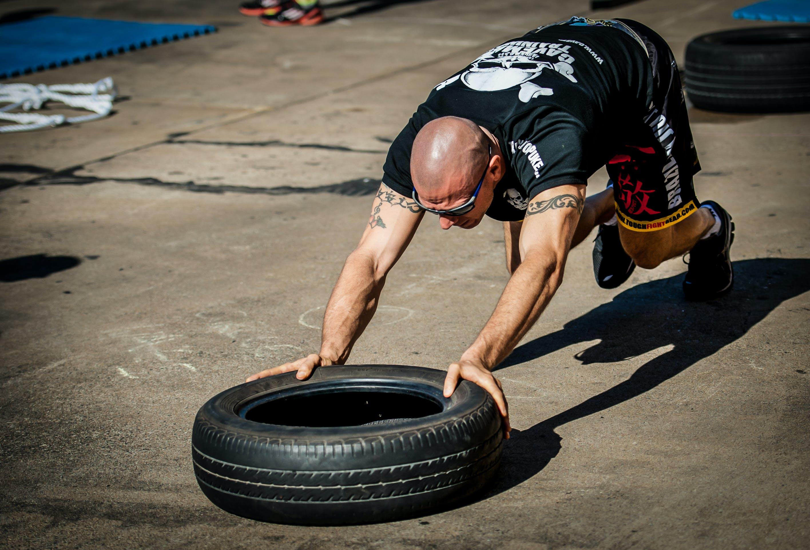 Free stock photo of cavemantraining, tyre push