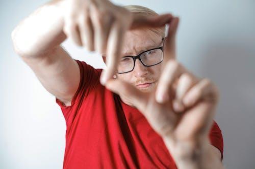 Photo Of Man Wearing Red Shirt