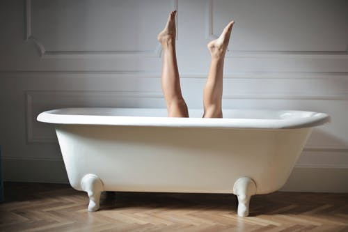 Photo of Female Legs in Bathtub