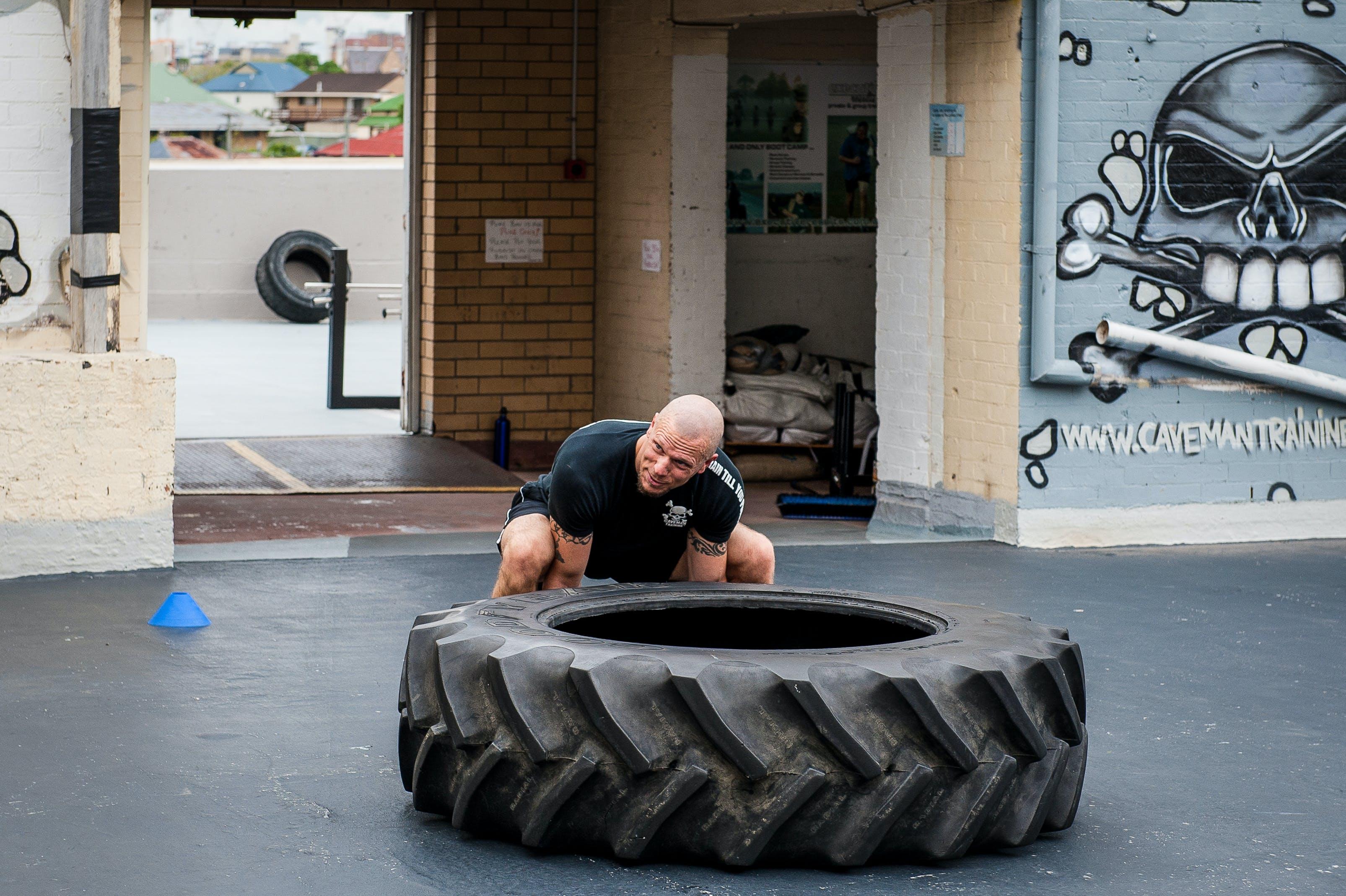 Free stock photo of tyre flip