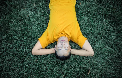 Photo of Person Laying On Grass Field