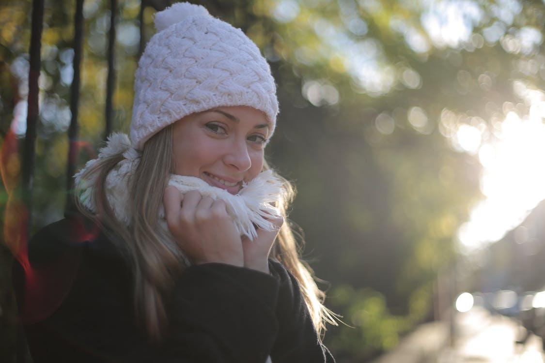 Photo of Woman Wearing White Bonnet