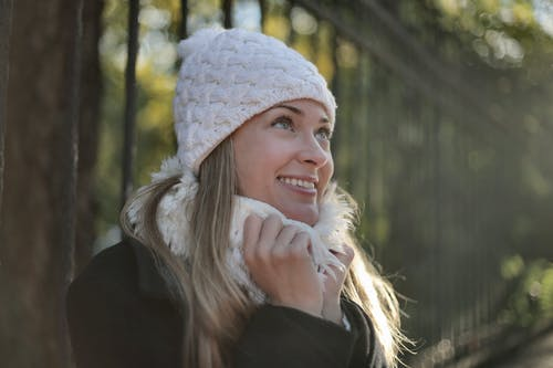 Photo of Woman Wearing White Beanie