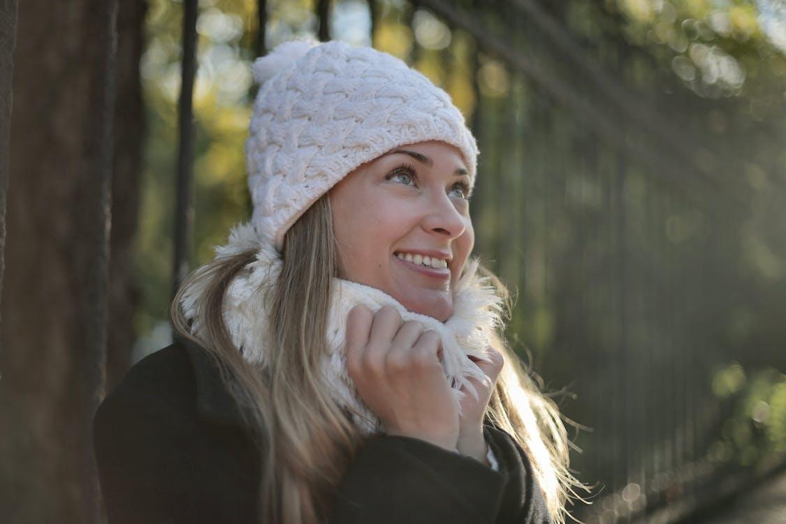 Photo of Woman Wearing White Beanie