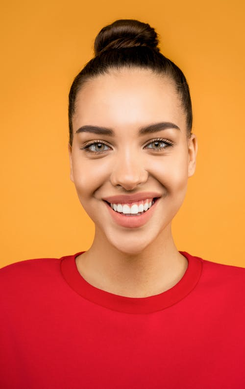 Smiling Woman in Red Crew Neck Shirt