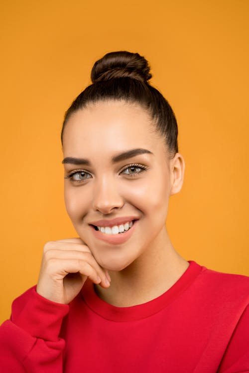 Woman in Red Crew Neck Shirt Smiling