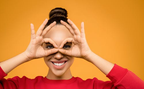 Photo of Woman Doing Hand Gesture