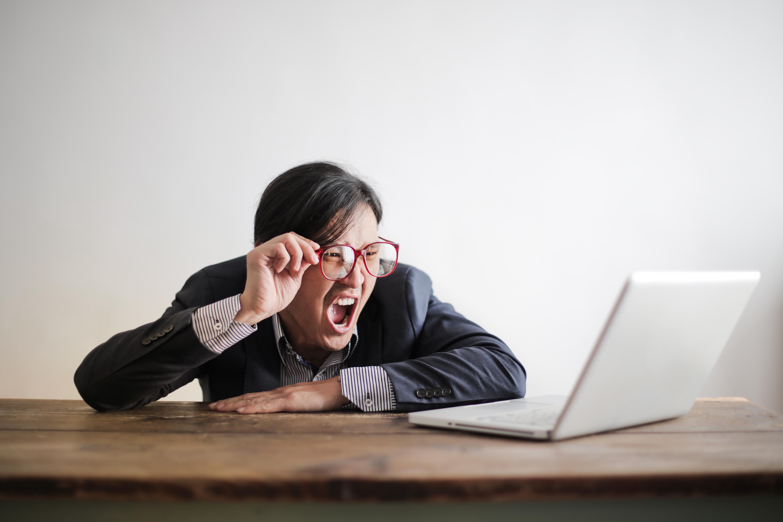 Man yelling at his laptop.