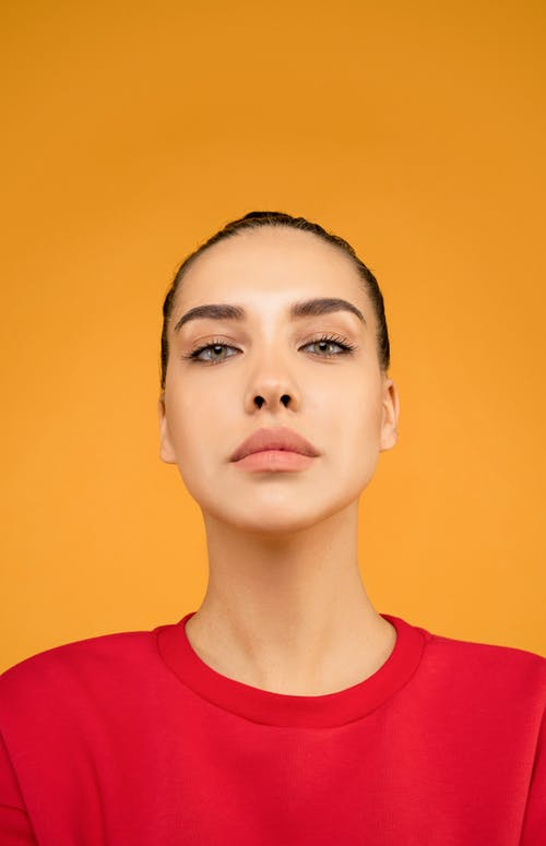 Portrait Photo of Woman In Red Top