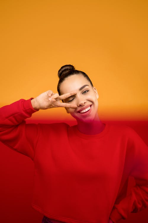 Photo of Woman in Red Sweater