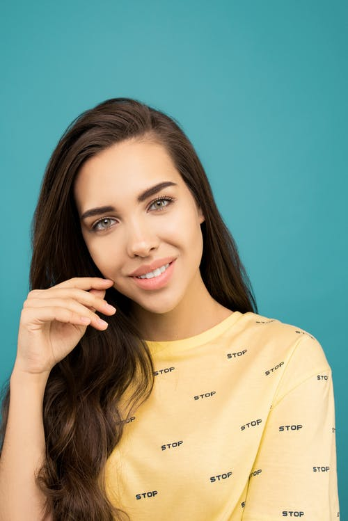 Photo of Woman In Yellow Shirt