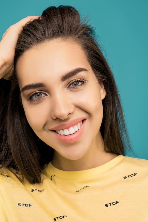 Close-Up Photo of Woman Wearing Yellow Shirt