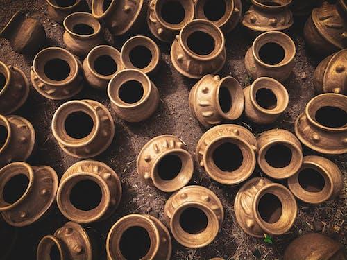 Handicraft different clay pots on ground in market