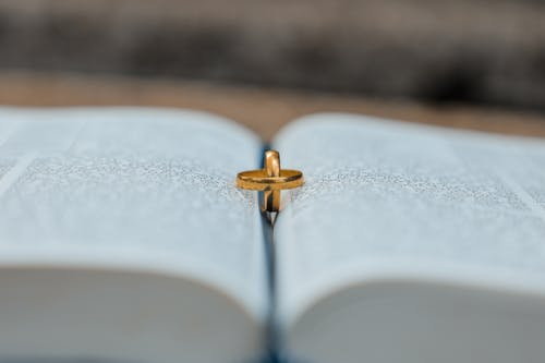 Golden rings on book during wedding day