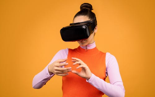 Woman Using Black Virtual Reality Goggles