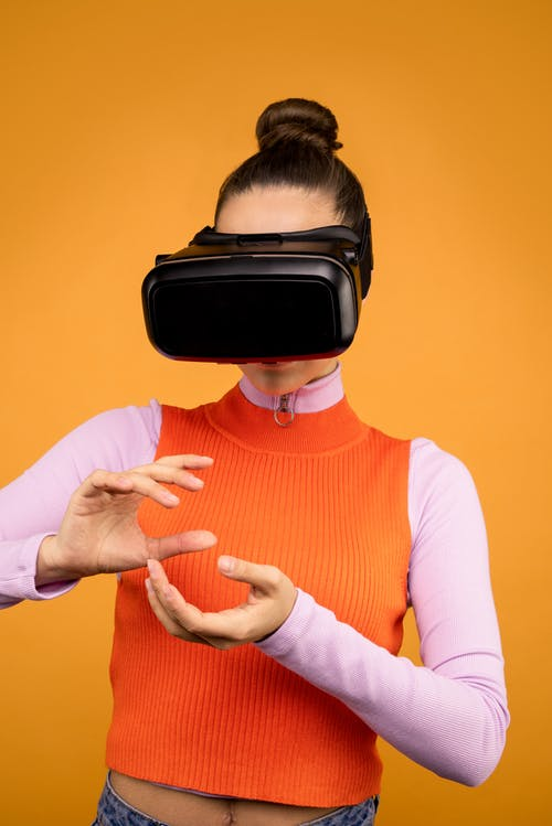 Woman in Long Sleeve Shirt Wearing VR Headset