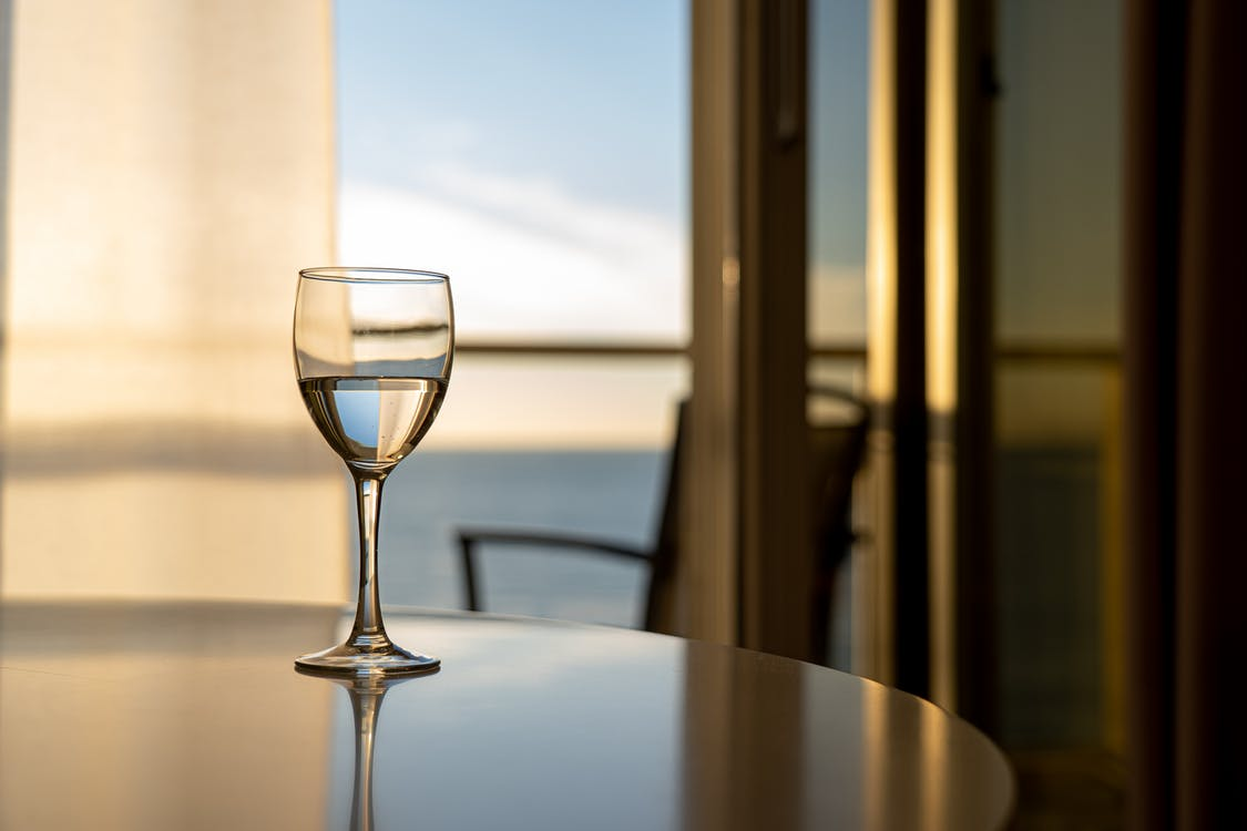 A Wine Glass On Dining Table