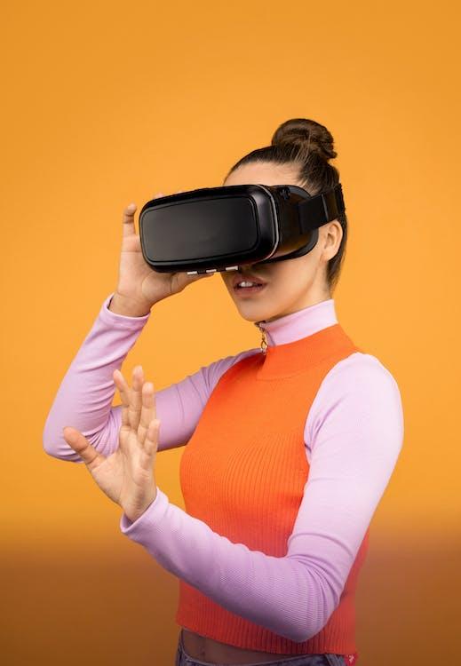 Woman in Long Sleeve Shirt Wearing Black VR Headset