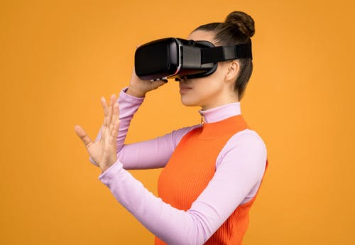Woman Adjusting Her Virtual Reality Headset