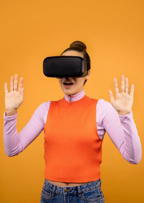 Woman in Long Sleeve Surprised by Virtual Reality