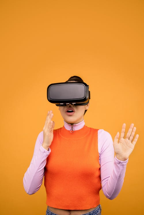 Woman in Long Sleeve Shirt Experiencing Virtual Reality