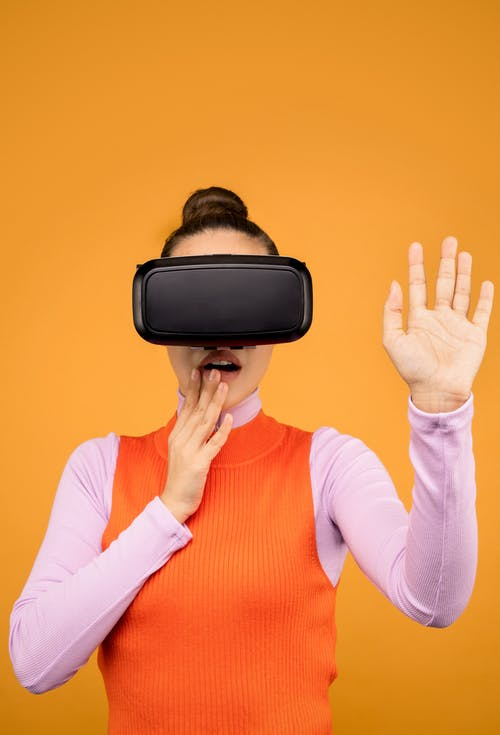 Woman in Long Sleeve Shirt Surprised in Virtual Reality