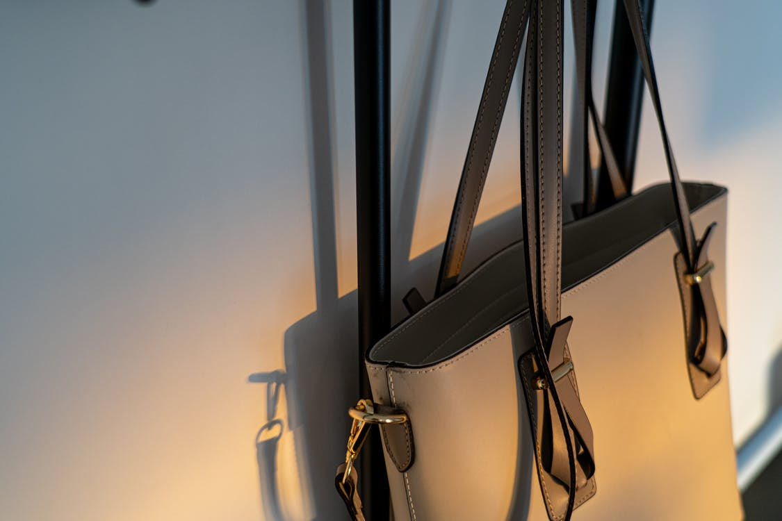Close-up Photo of a Handbag Hanging on a Wall
