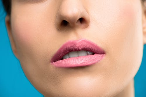 Close-up Photo of Woman With Pink Lipstick