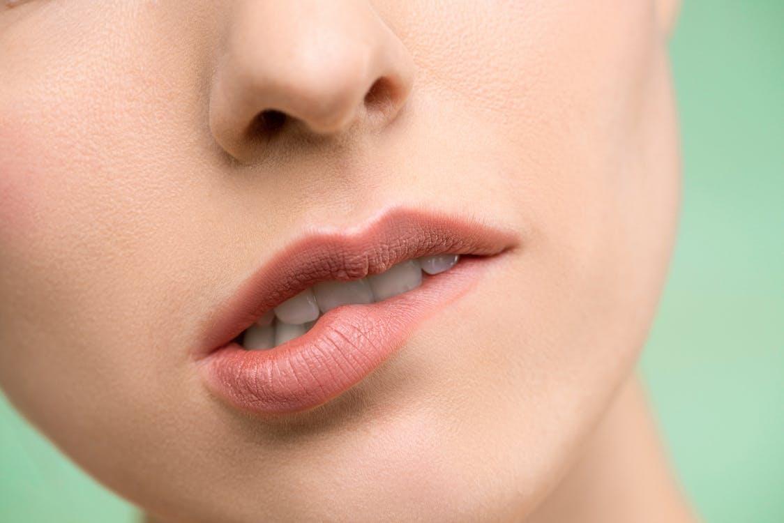 Woman Biting Her Lips