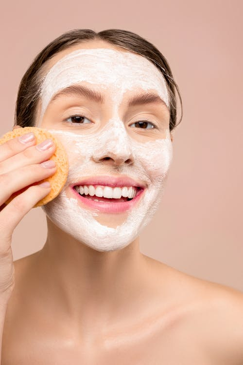 Woman With White Facial Wash on Face
