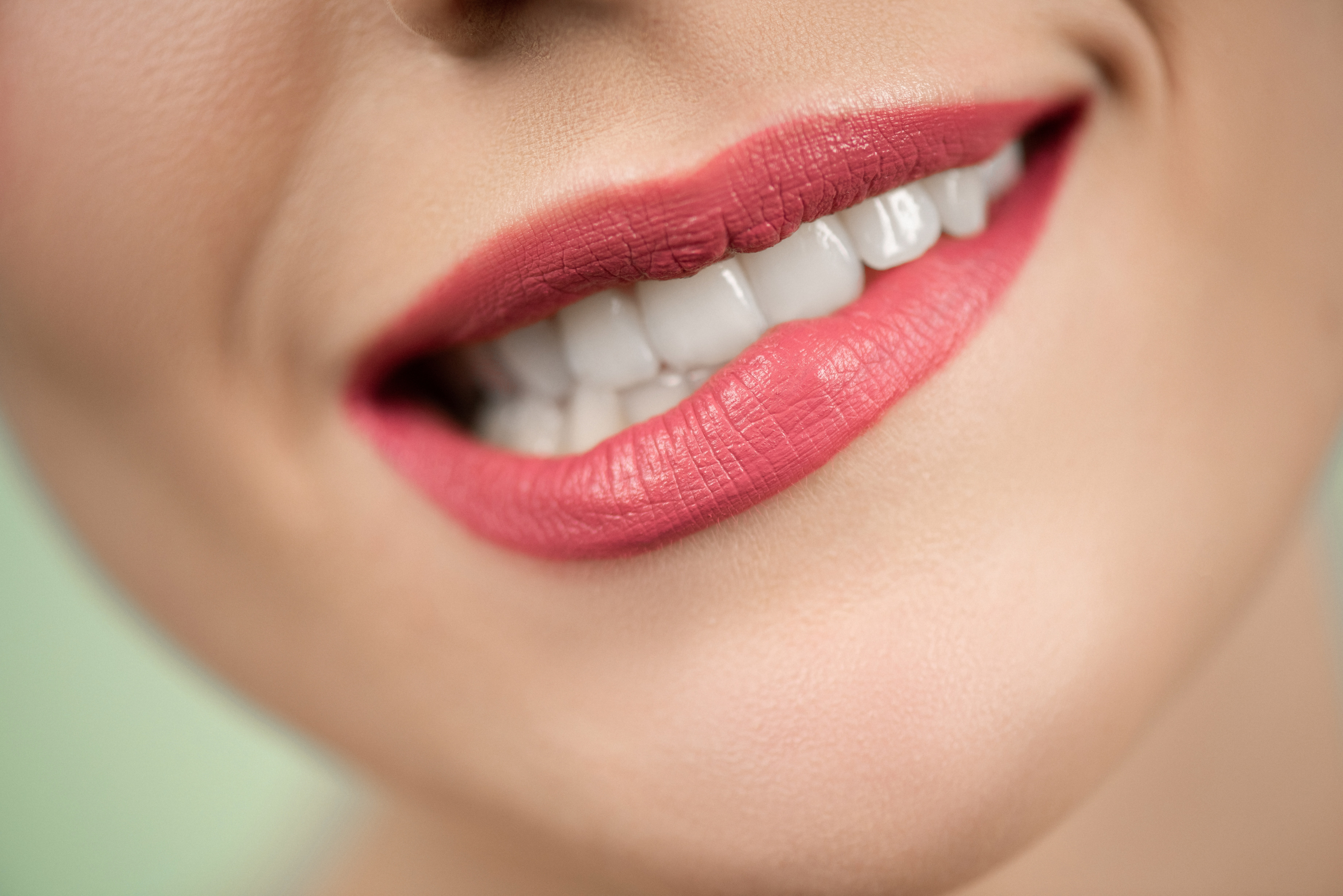 Woman With Red Lipstick Biting Her Lips · Free Stock Photo