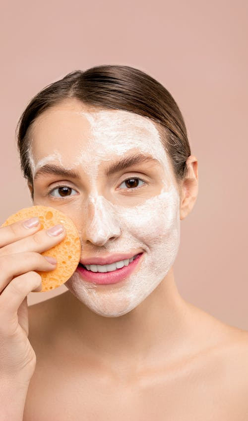 Woman With White Soap on Face