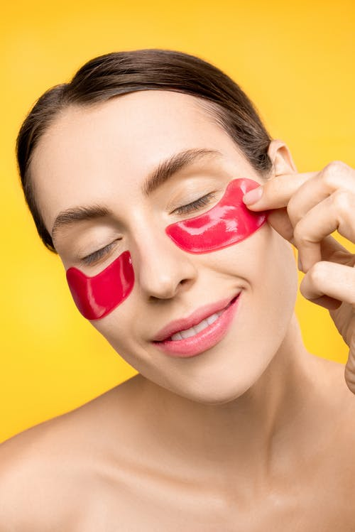 Woman With Red Under Eye Mask