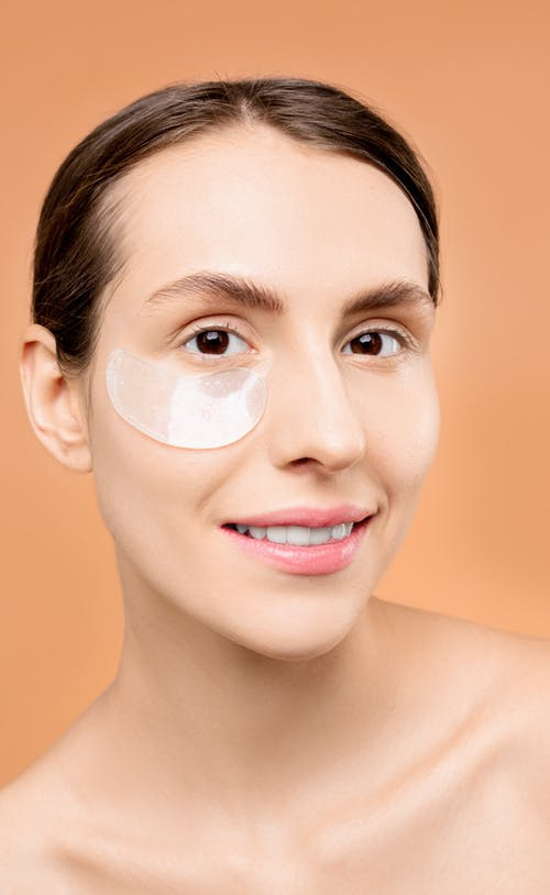 Woman With Clear Under Eye Mask on Her Face
