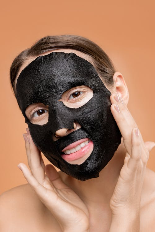Person Covering Face With Black Mask