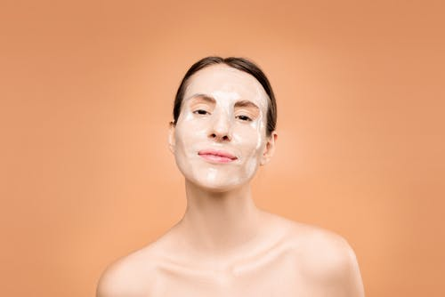 Topless Woman With Facial Mask