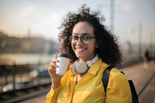 Woman With White Headset Drinking Coffee