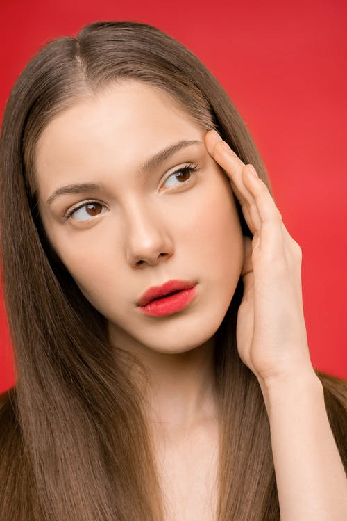 Woman With Red Lipstick and Red Background