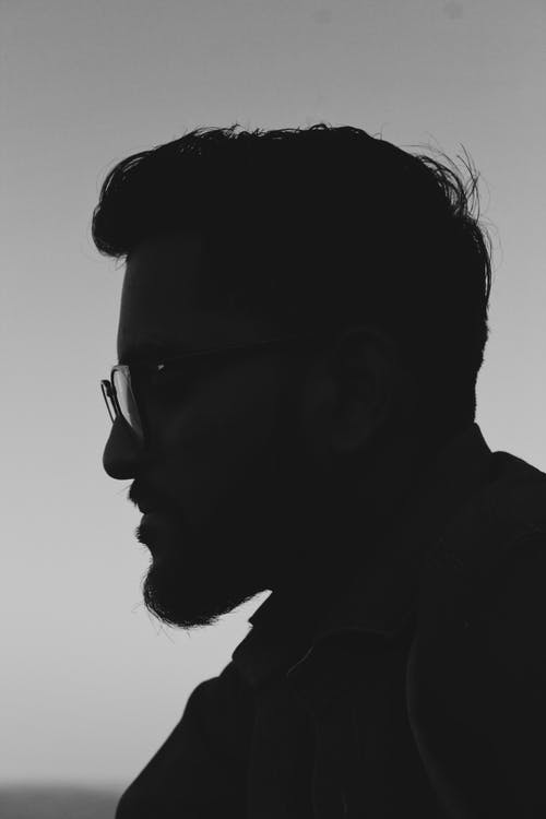 Grayscale Side View Photo of Man in Glasses