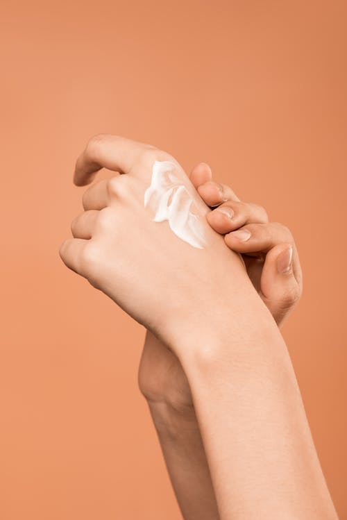 Person Applying Hand Cream