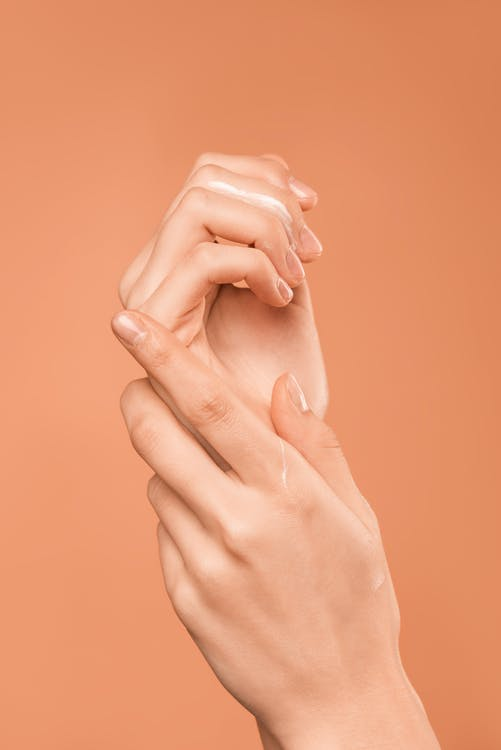 Persons Hand on Orange Background