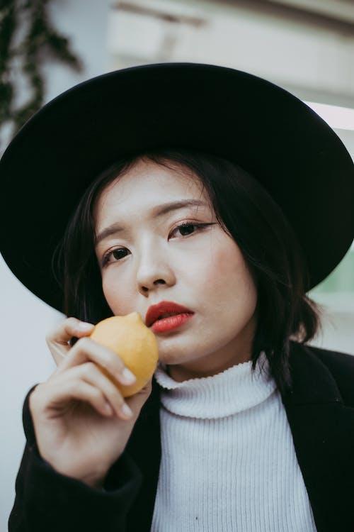 A Photo Of A Woman Holding Lemon